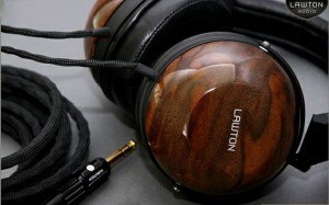 Lawton Audio custom made wood headphones, walnut finish with dry transfer logo rubbed down onto side earpiece. We make custom rubdown transfers for finished wood, like headphones, guitars and violins.