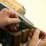 Applying rub down transfers on a scale model replica yacht by Classic Yacht Models