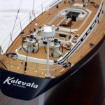 "Scale model replica of a yacht yacht is a custom built Swan 60 with an extended transom (now measuring 65' in length). The owner closely involved in the yacht's building process in 2002 has since sailed her around the world. Kalevala is a sloop and we built the model of her at 7/16"" scale. The model measures about 28 inches long by 43"" tall with a beam of 7-5/8""."