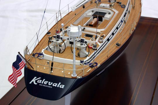 """Scale model replica of a yacht yacht is a custom built Swan 60 with an extended transom (now measuring 65' in length). The owner closely involved in the yacht's building process in 2002 has since sailed her around the world. Kalevala is a sloop and we built the model of her at 7/16"""" scale. The model measures about 28 inches long by 43"""" tall with a beam of 7-5/8""""."""