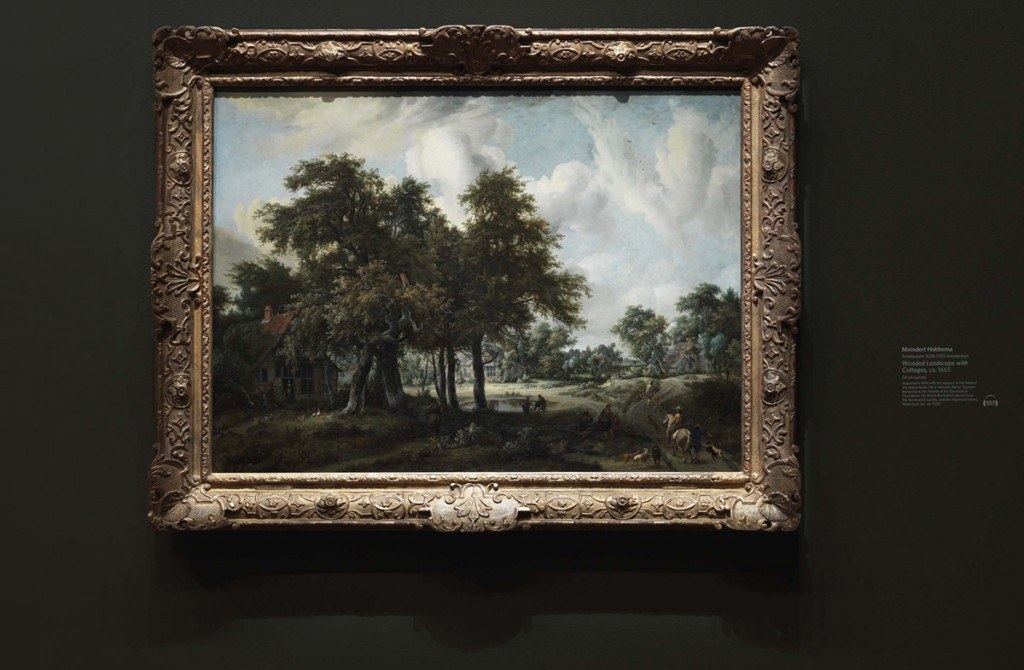A landscape painting by Meindert Hobberma in the deYoung gallery showing the artwork label