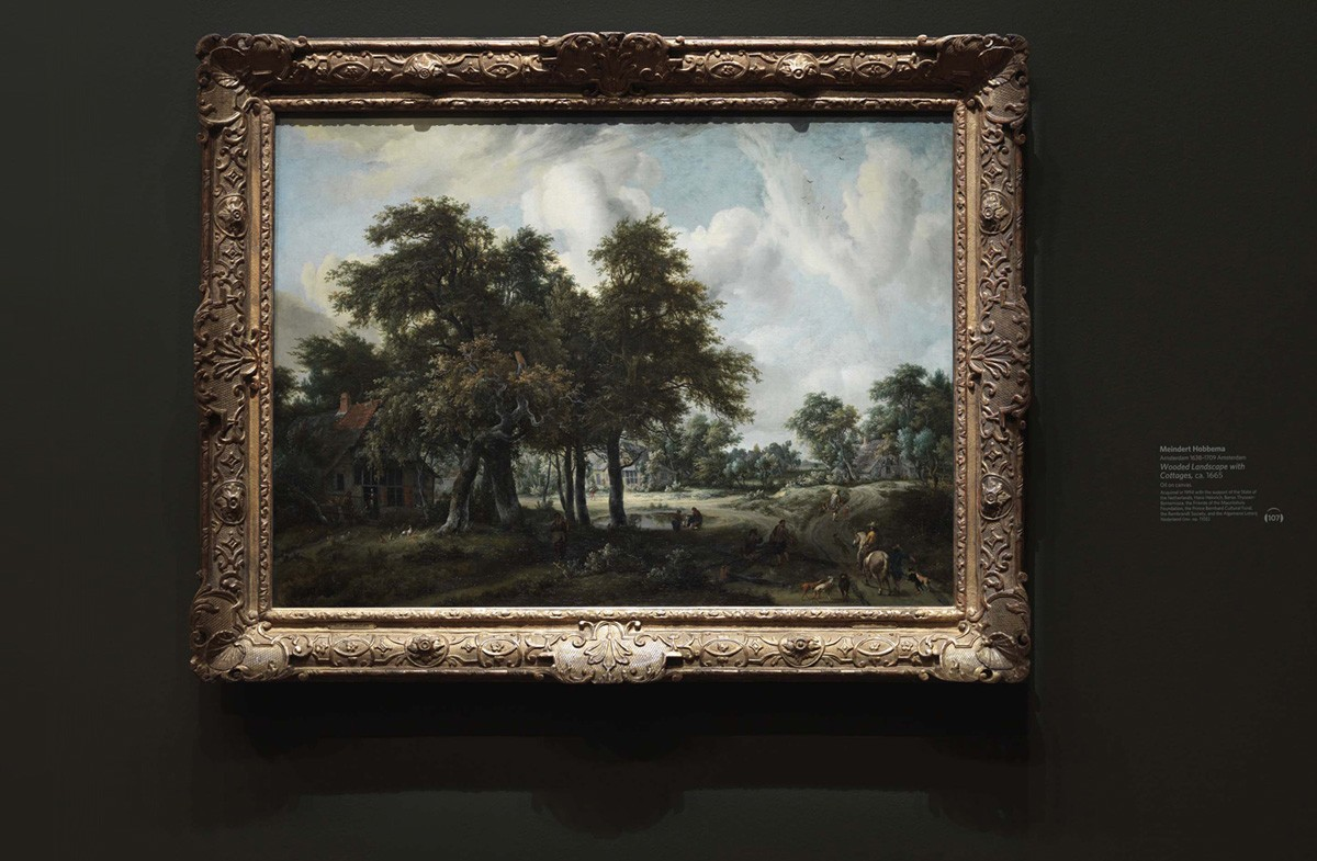 Museum wall labels using dry transfers. A landscape painting by Meindert Hobberma in the deYoung gallery showing the artwork label