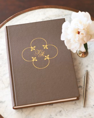 We custom made a dry transfer for Martha Stewart's Weddings magazine. Picture of a wedding guest book with a gold foil rubdown transfer.