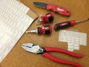 Photographers for Milwaukee Tools took this photo of our dry transfers being used for their product prototype photoshoot. This image shows different tools with the Milwaukee Tool logo applied on the surface of the prototype product using custom transfer decals
