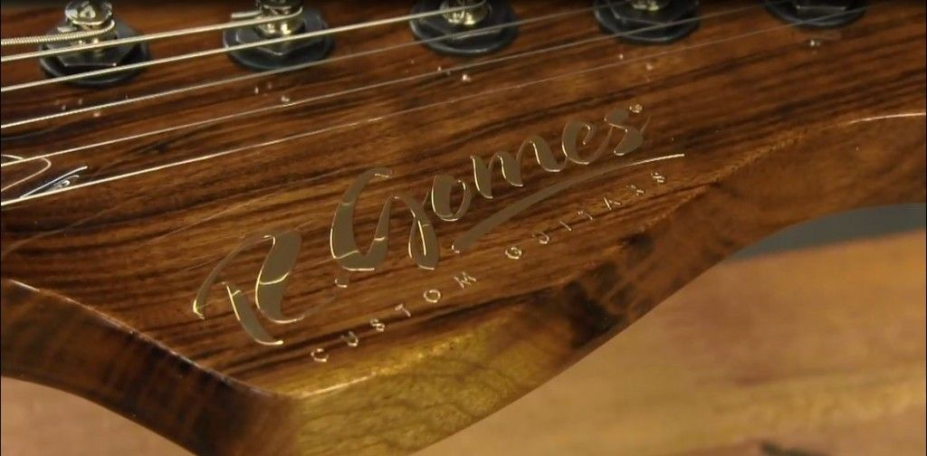 A closeup videocap of a metallic transfer foil applied on a custom guitar in a video from Stewart-MacDonald guitars and string instruments