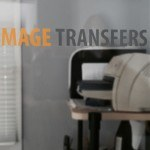 The image transfers logo applied as a custom dry transfer to a interior glass door. Rub-on transfers can be used for corporate branding on glass.