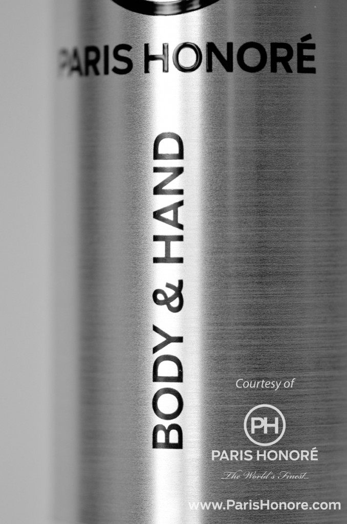 A closeup detail of a custom dry transfer decal rubbed down on the surface of a bottle. Thin lettering is assured.
