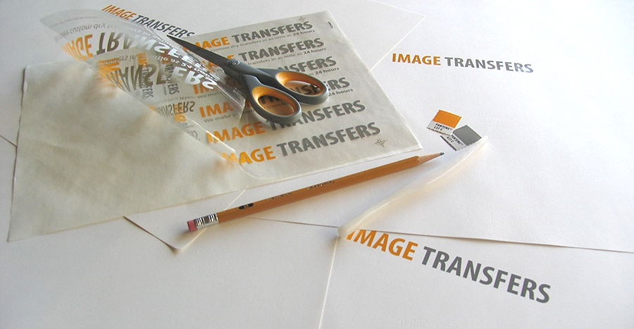 a custom dry transfer from Image Transfers Inc with scissors and burnishing tool on desktop