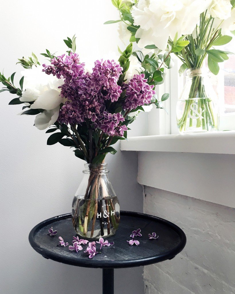 Product photo of flowers in a glass bottle by half and half flowers