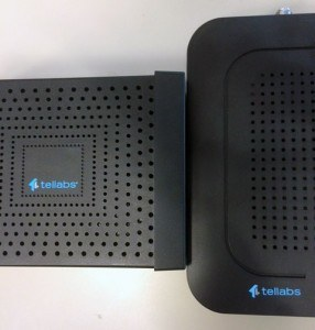 Our custom dry transfer decals on Tellabs' logo rubbed down onto the plastic case of their VOIP prototype device