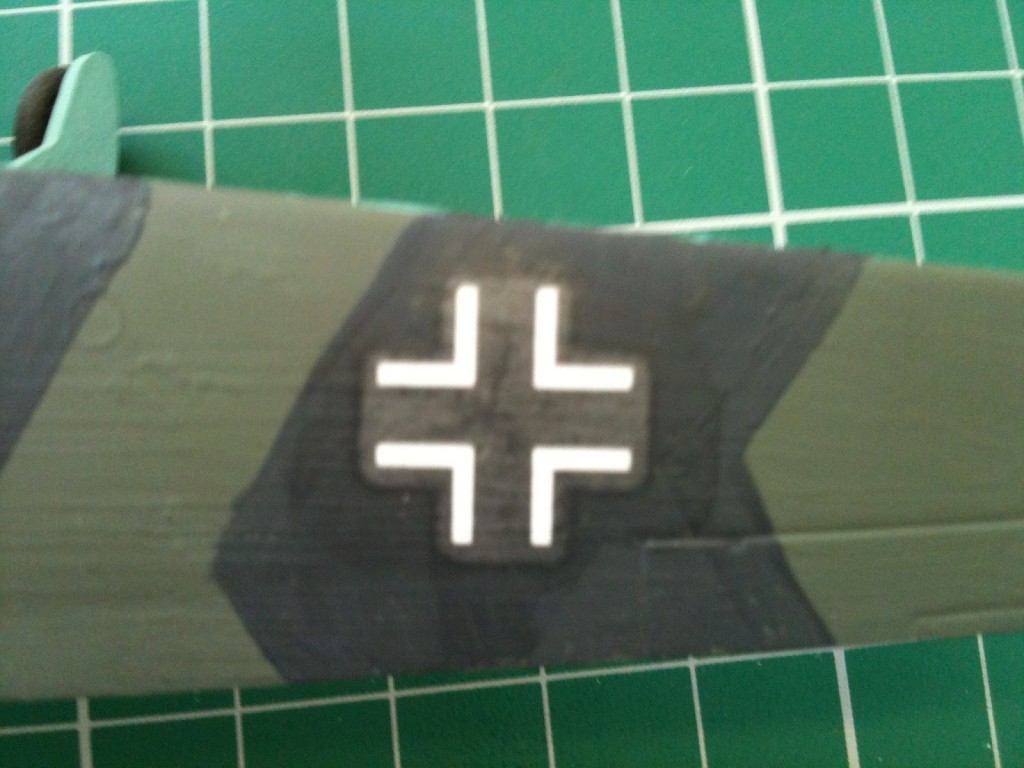 A water slide decal on a model airplane, the discolored edges are clearly visible