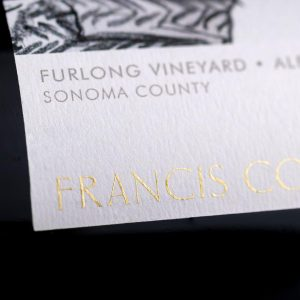 Closeup of dry transfer decal on glass wine bottle label for Francis Ford Coppola wines.