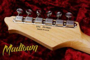 Custom transfer decal on a gutar head by Madtown guitars.