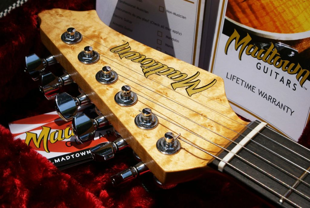 Close up of custom transfer decal on guitars.