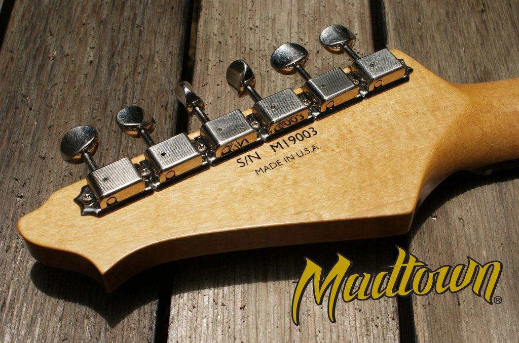 A custom guitar decal transferred onto a Madtown guitar neck.