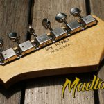 A custom guitar decal transferred onto a Madtown guitar neck.