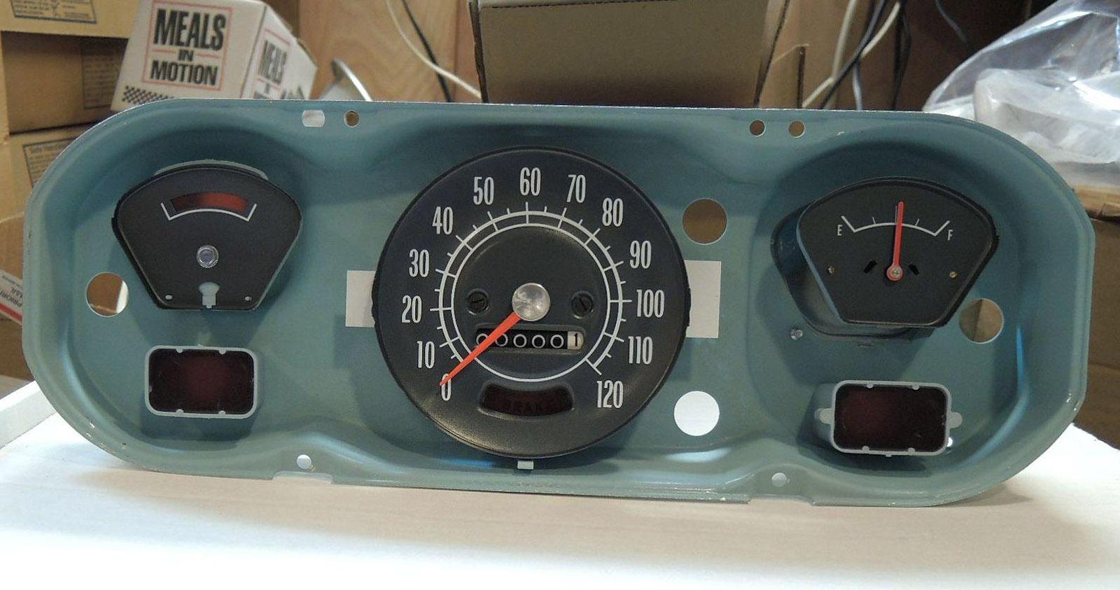 A vintage automobile dashboard with a dry transfer decal used to restore the speedometer and fuel gauge on a classic car. Classic car restoration decals.