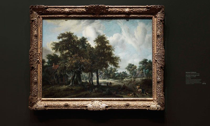 A dutch painting from the de Young Museum with a custom dry transfer on the wall beside the art piece used as a label or caption.