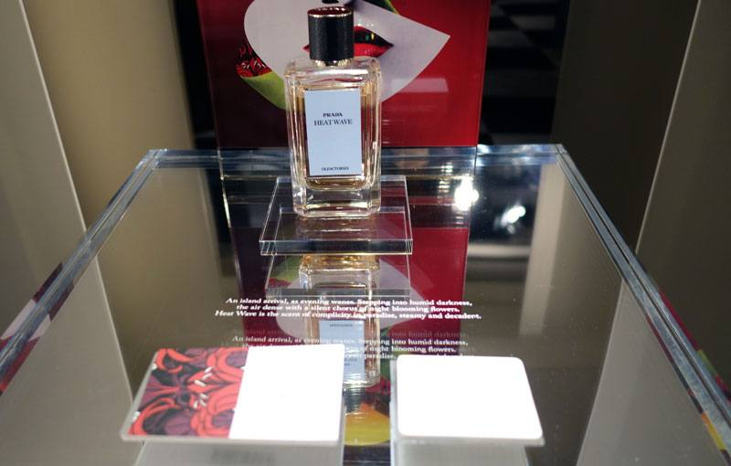 A top view photo of the Prada Glass Display using a custom rub down transfer for the white lettering, as a letraset transfer applied on the top of the display.